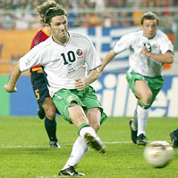 Robbie Keane scoring a penalty against Spain at World Cup 2002