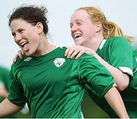 Two Irish Women Soccer Players Celebrate Scoring a Goal