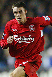 Darren Potter playing  football for Liverpool