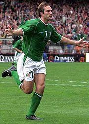 Jason McAteer playing football for Ireland