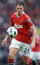Jonny Evans playing football for Manchester  United