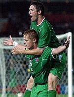 Damien Duff and Robbie Keane celebrate  Duff's goal against Saudi Arabia