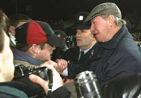 Jack Charlton grappling with and English fan at Lansdowne Road in 1995