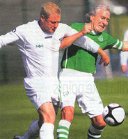 Mick Lawlor battling for the ball with England's Keith Sharp