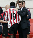 Roy Keane with Dwight Yorke